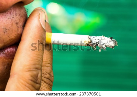 Cigarette in mouth. Bad habit, addiction, problems with health - stock photo