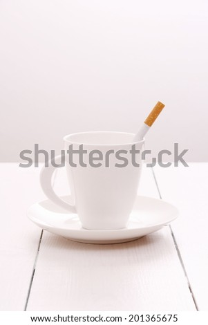 Cigarette instead of food - health concept, close up - stock photo