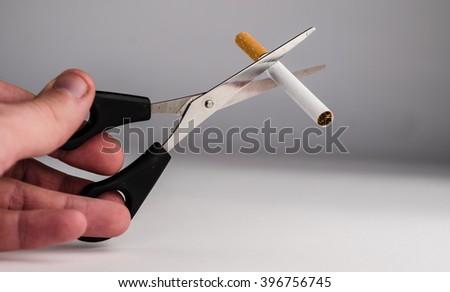 Cigarette, life, hand, scissors - stock photo