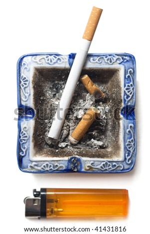 Cigarette, lighter and butts of cigarettes in the ashtrey - stock photo