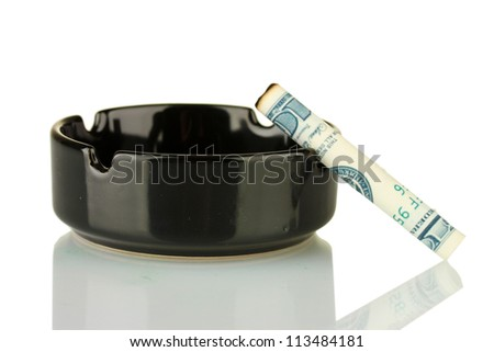 Cigarette of the 100 dollar bill and an ashtray isolated on white - stock photo