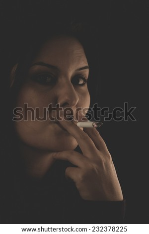 cigarette, Sensual brunette smoking, snuff smoke addiction - stock photo