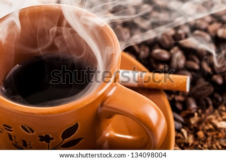 Cigarette, smoke and a cup o coffee
