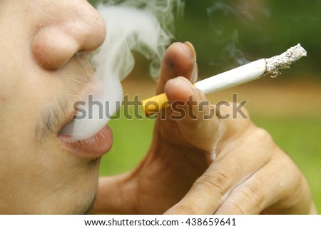 Cigarette smoking. - stock photo