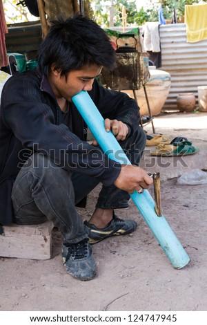 Cigarette smoking or marijuana in Northern Thailand - stock photo