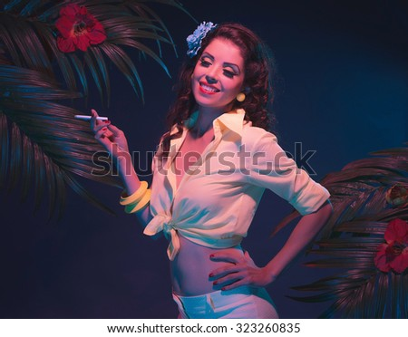Cigarette Smoking Tropical Fashion Pin-up in Evening Light with Palm Leaves.