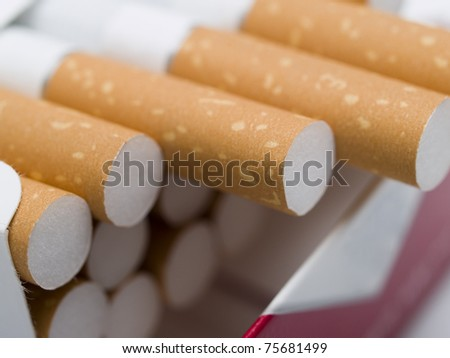 cigarette sticking out from the pack - stock photo