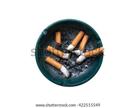 Cigarette stub in ashtray on white background. - stock photo