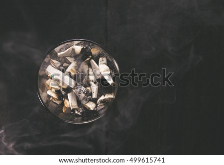 cigarette with ashtray on wood table. Empty ready for your product display or montage.