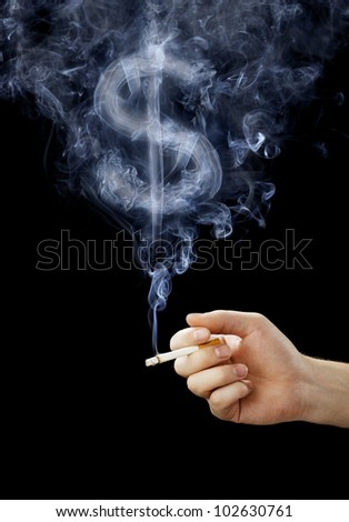 Cigarette with smoke shaped like a dollar sign. - stock photo