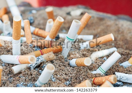 Cigarettes butt in ashtray - stock photo
