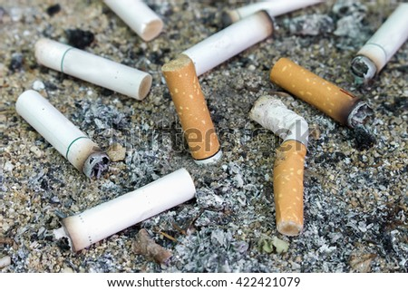 Cigarettes butt in ashtray [blur and select focus background] - stock photo