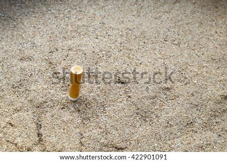 Cigarettes butt in sand ashtray - stock photo