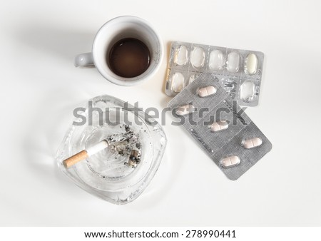 Cigarettes, coffee and pills - stock photo