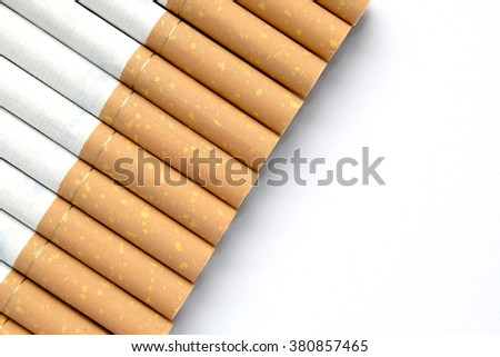 Cigarettes in a row on an isolated white background with copy space for additional messages - stock photo