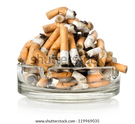 Cigarettes in an ashtray isolated on white background - stock photo