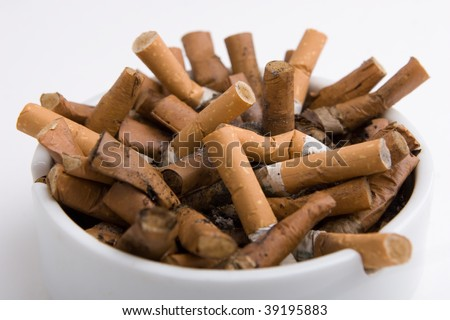 Cigarettes in an ashtray on white