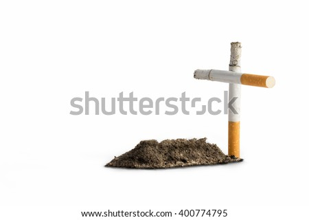 cigarettes like a cross and tomb - stock photo