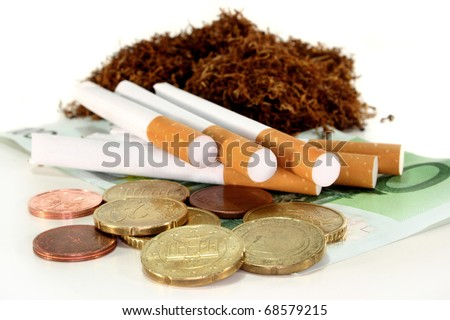 Cigarettes, money and tobacco on white background