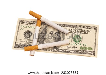 Cigarettes on one hundred dollar bill on white background