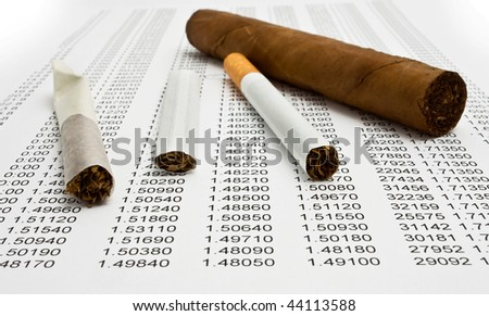 cigarettes on paper - stock photo