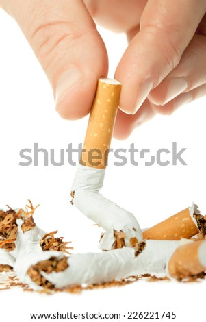 Cigarettes, smoke in various shades - stock photo