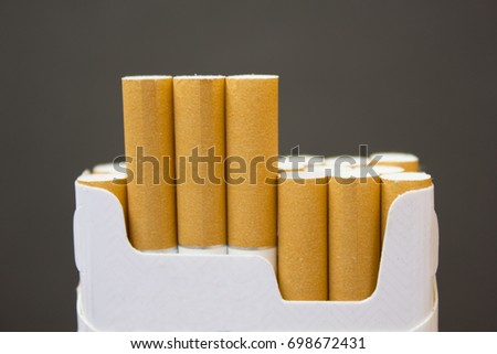 cigarettes stick out from the pack