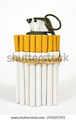 Cigarettes tied for manual granata- stylized idea representing health hazard of smoking - stock photo