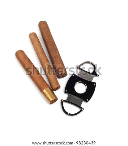 Cigars and a cutter isolated on white background - stock photo