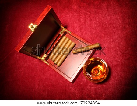 cigars in the box and glass with whisky, close up shallow dof - stock photo