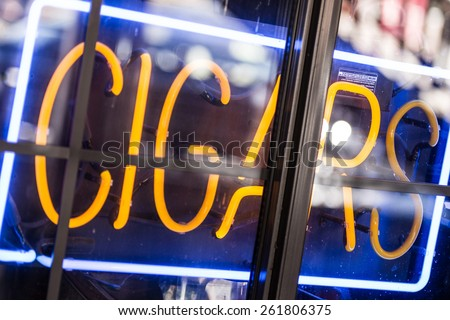 Cigars Store Display Advertising Neon Sign Closeup. - stock photo
