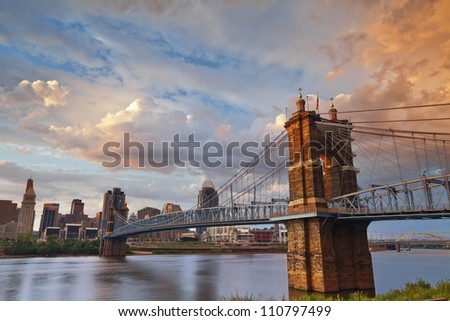 Cincinnati. Image of Cincinnati and John A. Roebling suspension bridge at sunset. - stock photo