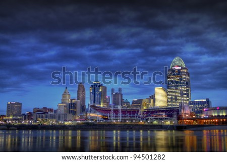 CINCINNATI – JANUARY 16: The skyline of Cincinnati, Ohio at night, January 16, 2012. Cincinnati is the third largest city in Ohio with a population of 296,943. - stock photo