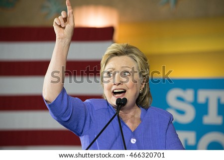 CINCINNATI, OHIO, USA - JUNE 27, 2016: Hillary Clinton makes a pointing up gesture at her campaign rally in the Museum Center with Senator Elizabeth Warren.