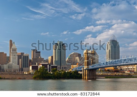 Cincinnati skyline. Image of Cincinnati skyline and historic John A. Roebling suspension bridge cross Ohio River. - stock photo