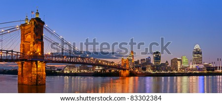Cincinnati skyline panorama. Image of Cincinnati and John A. Roebling suspension bridge at twilight. - stock photo