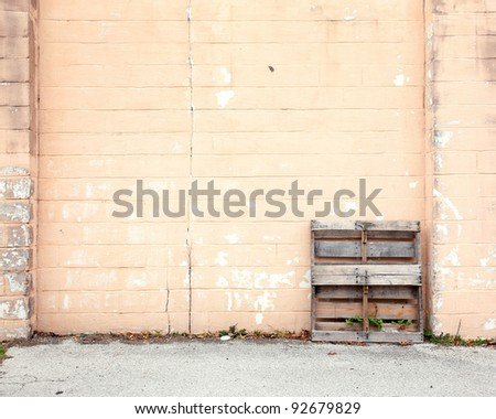 cinder block wall with palette background - stock photo