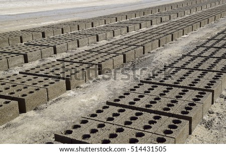 Cinder blocks lie on the ground and dried. on cinder block production plant