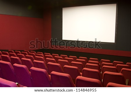 cinema and red seats rows empty screen
