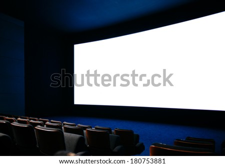 Cinema auditorium with large screen and empty seats - stock photo