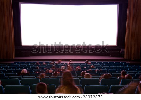 Cinema auditorium with line of chairs, sitting visitors watching the movie and silver screen. Ready for adding your own picture.