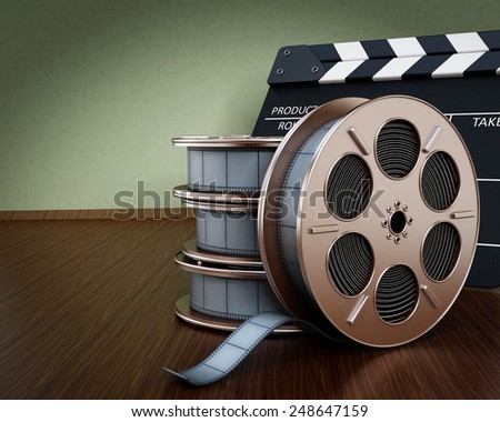 Cinema background with film reels and clapboard - stock photo