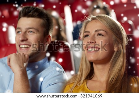 cinema, entertainment and people concept - happy couple watching movie in theater
