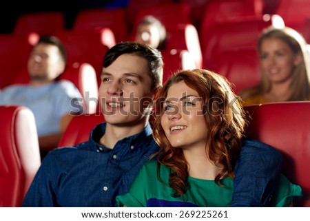 cinema, entertainment and people concept - happy friends watching movie in theater - stock photo