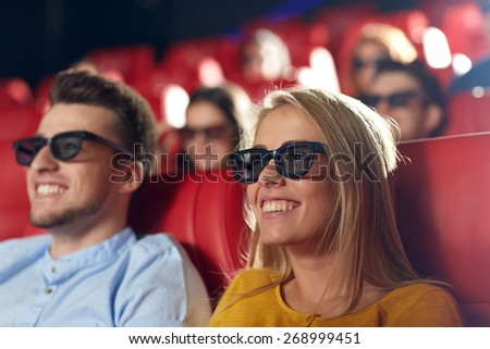 cinema, entertainment and people concept - happy friends with 3d glasses watching movie in theater - stock photo