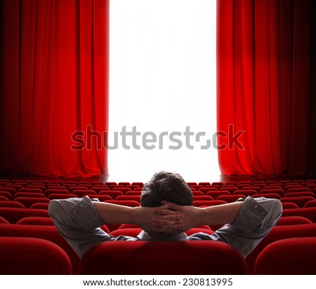 cinema screen red curtains opening for one vip person - stock photo