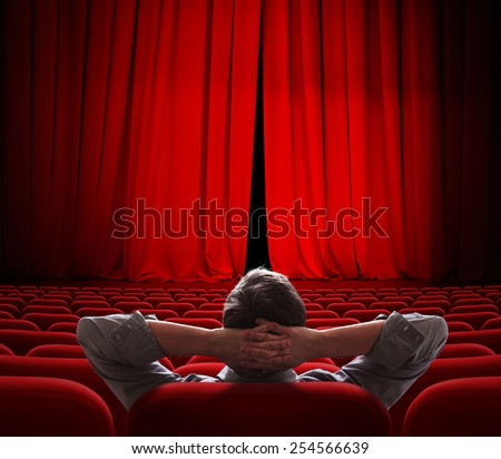 cinema screen red curtains slightly open for vip person - stock photo