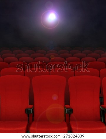 Cinema seats with projector lights - stock photo