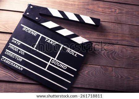 Cinema. vintage photo of movie clapper on wood - stock photo