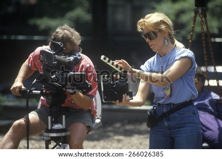 Cinematographer with equipment filming music video, Chicago, Ill - stock photo